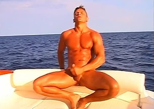 Leslie Manzel relaxes alone in a giant rubber raft, satisfying himself below the ocean's sun, in this 8 minute solo scene.  Supposing outdoor scenes are serene, there's no thing that suspends time quite like a gorgeous rod everywhere a big cock, stroking himself on th