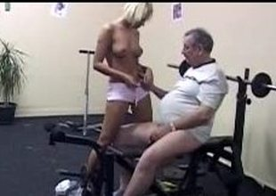 Blond cutie pleases her old trainer at the gym