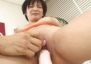 Asian breasty floozy tries out the sextoy