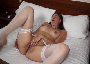 Nice-looking colourless stockings on a masturbating milf