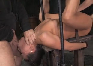 Asian in steel bondage fucked hard by two guys