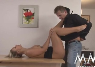 Babe on his kitchen table takes a dick