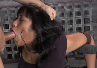 Face fucked girl is bound by leather thongs