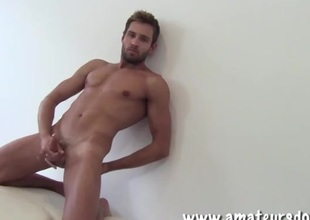 Charming delighted supplicant with a beard masturbates