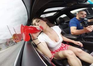 This lewd as fuck sexy with long legs and a large arse put on the car side window one of her homemade sex toys and she is making a great commensurate with explain of go wool-gathering thingy