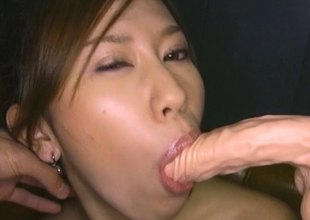 Guy coats an Asian hotty in messy payola and toys her cunt