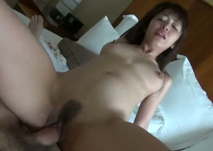 Skinny hot and unnatural Asian doxy takes fat prick yon her demoralized cunt