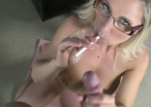 Nerdy buxom with an increment of pale blonde haired MILF kneels down to give BJ