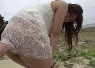 Nasty Japanese cutie Mayuka Akimoto gives blowjob on the run aground