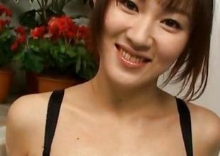 Japanese AV Model fondles her slit with the addition of boobs