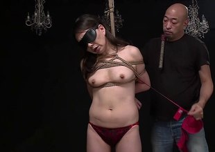 Asian slave has her pair tied with rope while he bonks her