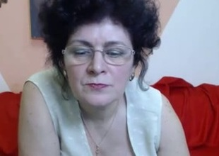 Mature brunette disrobes and fingers say no to snatch in webcam show