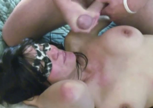 Brunette mother wearing a mask sucks a ramrod and gets facialed