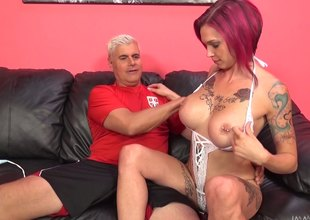 Tattooed redhead wide giant titties get thoroughly bonked wide a monster cock in a reality shoot