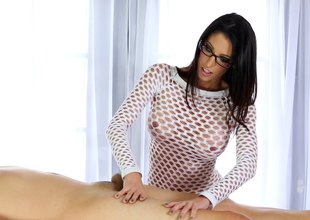 Brunette knockout in glasses delivers a sloppy blowjob before riding a schlong