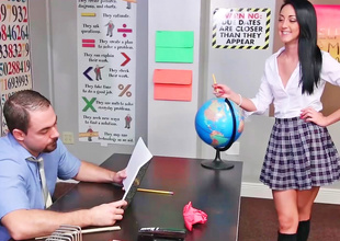 Unartificial schoolgirl is bored at detention in this scene.