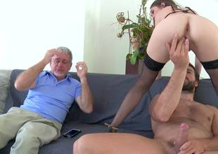 A brunette with small tits is getting rammed by a younger dude