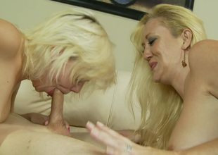 A couple of blonde bitches are doing some sexy work in a three-some