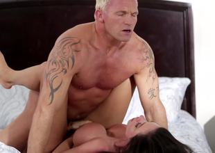 A blonde dude is pushing his dong into a hot and sexy milf