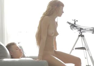 Sensual riding redhead with a lean teen body