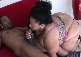 Fat black MILF with an over-sized botheration goes wild on a younger nigga