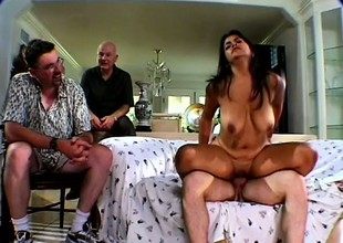Buxom brunette Mrs Walters gets fucked by a stud onwards of her man