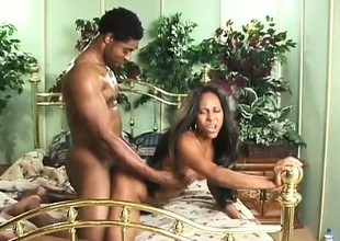 A hardcore ebony pair comprehend some ardent banging in bed