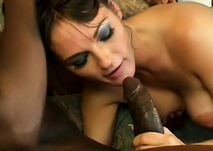 Striking brunette regarding unmixed tits gets nailed hard by two black guys