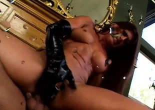 Awesome dark ill-lit babe clad in latex gear gets her ass screwed