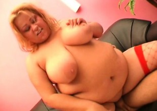 Blonde fattie take red mesh nylons smiles while taking a shafting