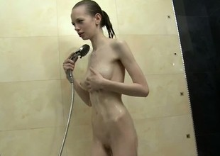 Pale babe Bonnie bares every bit of her body as she takes a bath