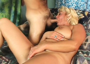 Older blonde loves to try a sausage shoved relative to her throat