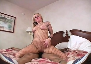 An eager blonde straddles a dark stud and rides his cock well