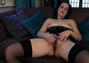 She tries to make her mature body become visible sexy in lingerie together with plays with her hairy hole