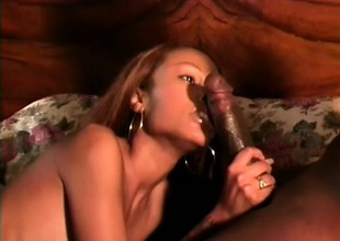 Black skinned beauty with big tits has a black stud hammering her pussy