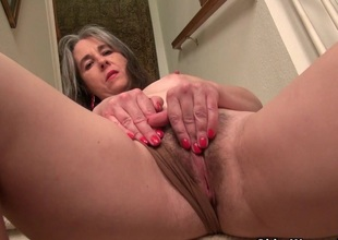 American milf Kelli strips off and masturbates out of reach of the stairs
