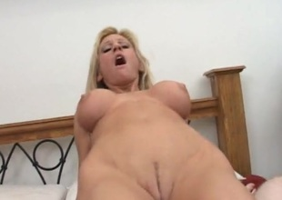 Bad mommy with implants loves his dick