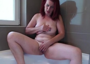 Large spoils older redhead rubs her hot holes