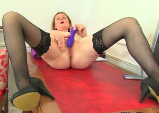 British milf Clare strips off their way secretary outfit and plays
