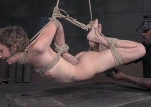 Anorectic cutie in a rope bondage suspension suffers traduce