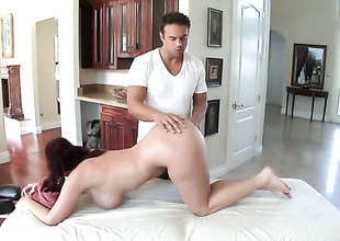 Sophie Dee is having a massage