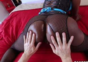 Dark skinned MILF in fishnet pantyhose puts her big felonious ass on display and then gets ehr throat rim with hard white dick. This babe sucks soft-hearted guys ivory schlong like a pro!