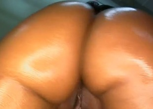 Charming ebony darling enjoys engulfing stud's  pecker