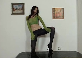 Alluring leggy brunette puts pantyhose on her head while masturbating