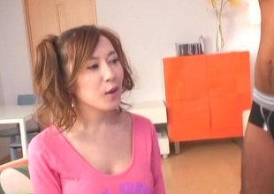 Sexy Japanese girl in pigtails and thigh high nylons sits on her chap