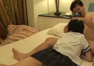 Short haired Japanese coed girl gives BJ plus gets poked missionary