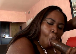 Super huge fat black bitch sucks plucky black dick before doggyfuck
