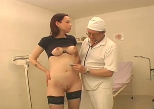 Kinky doctor examines hairless pussy be required of one young chick Vika wearing hawt stockings