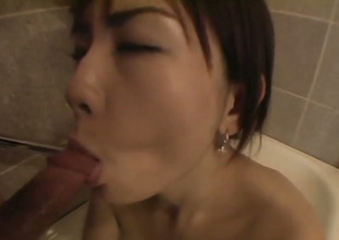 Cute Japanese gal does her win out over dimension sucking lollicock on foamy bath