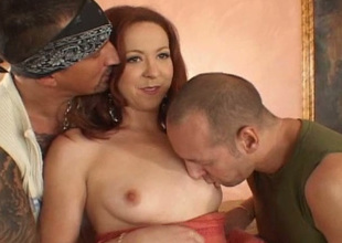 Redheaded bitch gets two cocks all over satisfy her sexual hunger